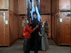 Felicia and Laura Holt find Remington Steele bound and hanging on a rope