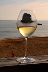 Wine on'the rocks (suzyesue) Tags: light sunset sea sun holiday tourism beach portugal glass rock closeup bar dinner island golden seaside sand holidays paradise view wine drink tourist algarve seaview praiadoscanecos