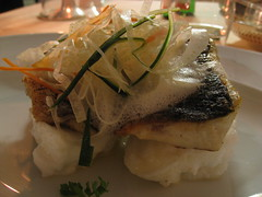 Bass escalope on summer dressing, served with fish sauce and a spring bouquet of vegetables
