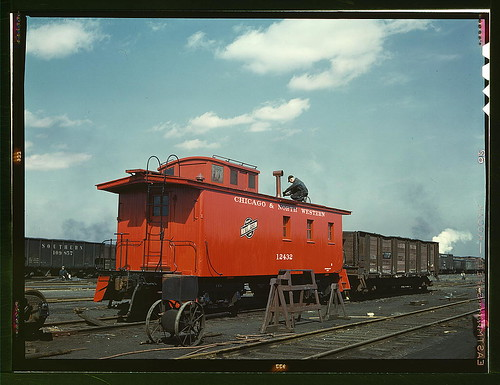 C & NW RR, putting the finishing touches on a rebuilt caboose at the rip tracks at Proviso yard, Chicago, Ill. (LOC)