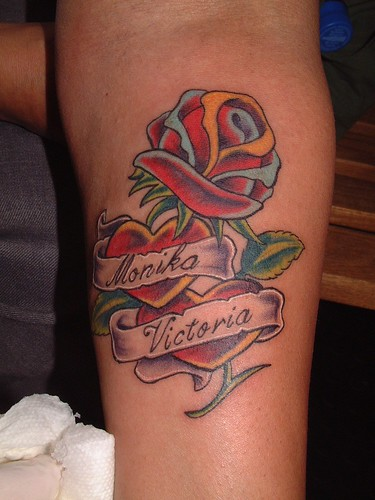 Labels: Rose Heart Tattoos