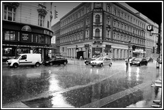 regen in wien - rain in vienna (~shrewd~) Tags: vienna wien street people urban bw white house black reflection building cars wet water rain architecture