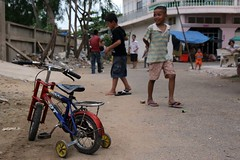 (eyrennay.shots) Tags: street boy playing bicycle canon cambodia phnom penh 30d