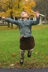 sadie jump (chromatophobe) Tags: autumn fall girl children jump jumping child touchthesky