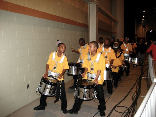 A kids' marching band leaves the Obama victory rally