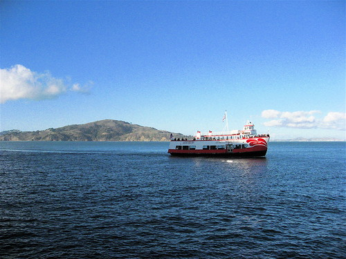 Angel Island and a Red and White tourist boat