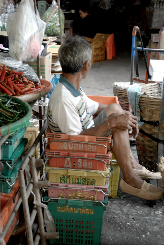 A Man in a Basket, in a Market, in Bangkok