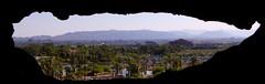A view of Phoenix Through A Slightly Smaller Hole (Kat Davis ) Tags: arizona phoenix rock hole cave phoenixzoo papagopark desertbotanicalgardens kathydavis papagobutte 7daysofshooting filltheframefriday week41throughahole katdavis katdavisphotography