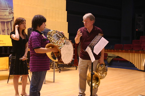 William Purvis works with a horn student on a Mozart Concerto