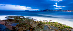 All blue, but the rocks (Dante Laurini Jr) Tags: ocean sunset pordosol sea brazil rock brasil clouds sunrise mar areia dante sp junior nuvens reflexo reflexos relfection outros oceano guaruja rocha laurini pedrs vosplusbellesphotos dantelaurinijunior