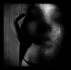 .... (Unfurled) Tags: light shadow portrait woman face female photoshop self dark skin body manipulation form hip curve shape dreamscape lightroom