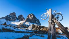 Bicycle (Nicola Pezzoli) Tags: nature snow winter val gardena italy tourism colors dolomites dolomiti mountain santa cristina ortisei gröden alto adige sassolungo passo sella bicycle blue sky