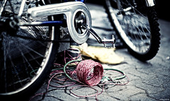 But Now Things Were Different, with Birds Unable to Speak | 143.365 (Stephan Geyer) Tags: colour bicycle wheel contrast canon dubai dof bokeh 85mm string 5d canon5d canoneos5d project365 8512 85l ef85mmf12lusm canon5dclassic