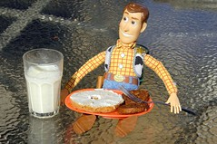 Woody Sits Down to a Breakfast of Two Sausage Patties and a Bagel (ricko) Tags: food glass breakfast toy milk doll toystory sausage woody plate fork bagel messingaroundwithgrandkids