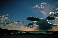 Isolated Showers (s0ulsurfing) Tags: ocean blue light shadow sea sky cliff cloud sunlight seascape beach nature water rain weather silhouette clouds landscape island bay coast interesting skies natural bright shoreline si