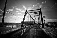 (Brooke Pennington) Tags: road city bridge winter sunset blackandwhite nature clouds skyscape michigan steel structure grandrapids grandriver brickroad historicbridge 6thstreetbridge brookepennington becauseistoodonit