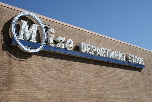 mize department store neon sign in sunlight