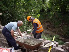 Volunteers at work rebuilding the parapet wall of the Wood Lane bridge