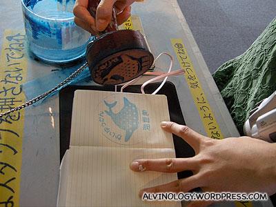Rachel collecting the Kaiyukan chop in her notebook