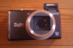 Canon PowerShot SX200 IS - Frot/Open