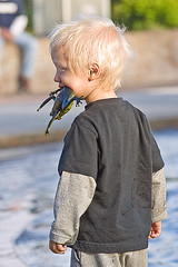 Blonde Boy Eating Frog