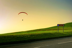 Parasailing... no Paragliding! (lowbattery) Tags: road morning cliff sun green grass countryside flying centre flight eastbourne roadsign paragliding extremesports glider tones hue parasailing beachyhead cliffedge piratetreasure countrysidecentre giantkite subtlehdr abigfave ultimateshot ysplix piratetreasure2