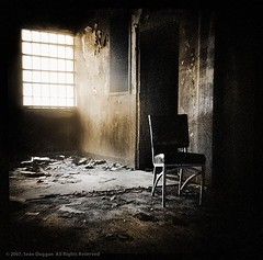 Sunlight finds a way in, but there is always more darkness than light (Sen Duggan) Tags: abandoned 120 film window strange mediumformat square riot chair f14 trix toycamera spooky prison diana jail inferno burned penitentiary charred scorched