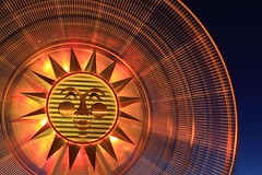 The Sun Machine (A Sutanto) Tags: california park christmas ca longexposure blue light vacation sky orange usa sun wheel america fun lights disneyland disney amusementpark bluehour anaheim themepark californiaadventure lively sunwheel lighttrail paradisepier earthnight aplusphoto