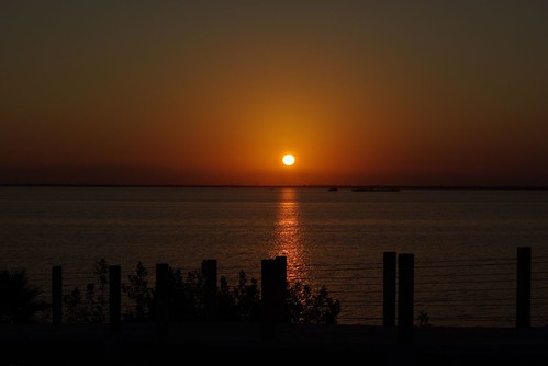Setting Sun over Cancun Lagoon - Copyright R.Weal 2007