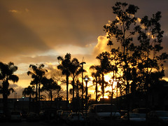 Stormy Sunset (bookish in north park) Tags: california sunset storm parkinglot sandiego explore missionvalley trolleystation novideo blueribbonwinner supershot abigfave novideos platinumphoto megashot goldstaraward