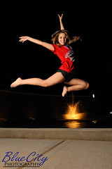 High Flying (Trask Smith) Tags: pictures portrait fountain senior portraits jump jumping texas photographer photos pics tx entrance photographs freeport leap leaping lakejackson 2011 exporters brazosportcollege brazoriacounty brazosporthighschool seniorshirt bluecityphotography bluecityphotographycom