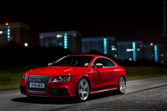 Poised: Audi RS5 in Misano Red lightpainted on long exposure (AndWhyNot) Tags: light lightpainting field car wheel night speed 35mm painting nikon key long exposure dof open power bokeh painted low wide fast arches highlights f2 grille audi depth v8 prestige lightpainted 5363 rs5