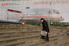 """We're changing for you"", promotion of high speed rail service Moscow--St. Petersburg, Moscow, Russia, November 8, 2007 (Ivan S. Abrams) Tags: arizona russia moscow canon20d ivan trains pedestrians getty redsquare abrams alstom railways kremlin sovietunion gettyimages railroads muscovy bombardier smrgsbord tucsonarizona briefcases passengertrains highspeedtrains adtranz 5photosaday 12608 alsthom onlythebestare ivansabrams trainplanepro pimacountyarizona safyan arizonabar arizonaphotographers russiastaterailways canonlensesareawful ivanabrams cochisecountyarizona tucson3985 gettyimagesandtheflickrcollection copyrightivansabramsallrightsreservedunauthorizeduseofthisimageisprohibited tucson3985gmailcom ivansafyanabrams arizonalawyers statebarofarizona californialawyers copyrightivansafyanabrams2009allrightsreservedunauthorizeduseprohibitedbylawpropertyofivansafyanabrams unauthorizeduseconstitutestheft thisphotographwasmadebyivansafyanabramswhoretainsallrightstheretoc2009ivansafyanabrams abramsandmcdanielinternationallawandeconomicdiplomacy ivansabramsarizonaattorney ivansabramsbauniversityofpittsburghjduniversityofpittsburghllmuniversityofarizonainternationallawyer"