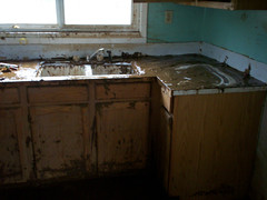 Cabinets continued to drip water, mud and sludge as we carried them from the house.  All her appliances large and small are ruined.