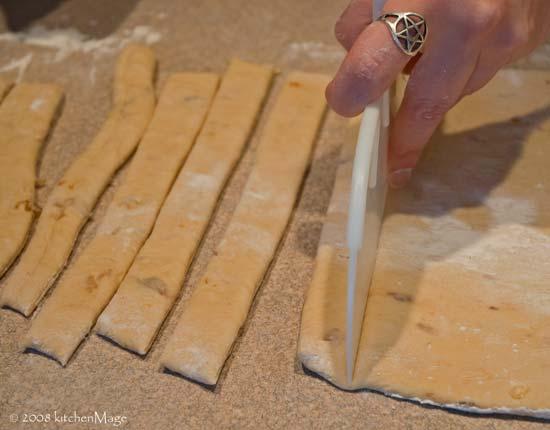 cutting onion cheddar breadsticks