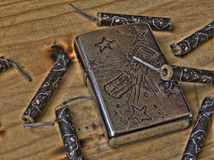 Firecracker Zippo (Burnt T045T) Tags: wood black cat paper real fire star high dynamic toast flames buddy boom burn cardboard burnt gift present lighter custom pyro range hdr explosives zippo firecracker fuse pyrotechnics necessity surivival t045t