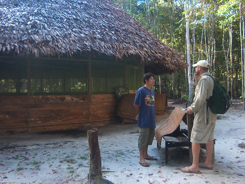 Julio & Martin evaluates every hut in the village