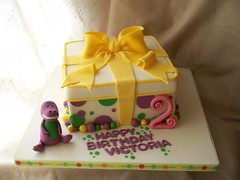 Barney gift box inspired cake with figure (Andrea's SweetCakes) Tags: green yellow purple spots birthdaycake bow barney giftbox