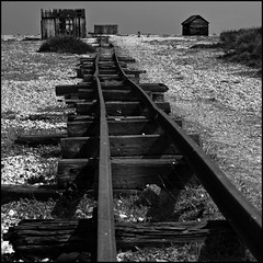 British, rail (David (UK) - Gone) Tags: england abandoned beach vanishingpoint kent decay shingle perspective rusty rails dungeness derelict sheds chdk