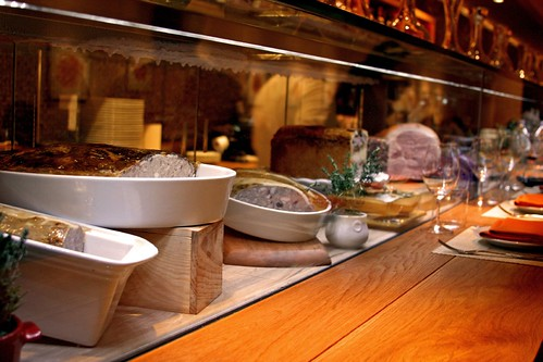 Their terrines and hams along the bar...