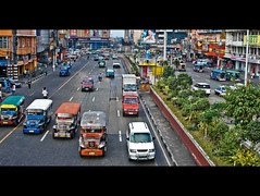 Jeepneys on an Unknown Street (the left-handed robot) Tags: street cars place events philippines style places location kind event bloggable area type areas category frogger automobiles milestone happenings jeepney locales locations locale occurence philippines07