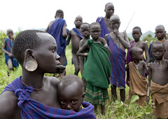 Surma people - Omo valley Ethiopia (Eric Lafforgue) Tags: africa woman childhood kids youth children kid child artistic plateau jeunesse ornament innocence omovalley enfants bodypainting ethiopia tribe 3200 rite enfant surma naivete argile labret adornment afrique pigments bluescarf tribu eastafrica suri enfance abyssinia ethiopie traditionalclothes piercedlip stretchedlip kibish nomadicpeople surmatribe habittraditionnel suripeople peuplenomade kibbish plateaulabial peoplesoftheomovalley piercedhole piercedlipornament surmapeople peuplesdelavalleedelomo tribudessuri suritribe tribudessurma peuplesuri peuplesurma villageofkibish villageofkibbish villagedekibish villagedekibbish peupledepasteurs pastoralistpeople levreetiree levrepercee ornementdelevrepercee femmeaplateau