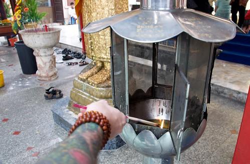 Lighting incense for prayer, Standing Buddha, Bangkok 2011 6