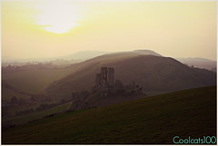 Sunset over Corfe Castle (Coolcats100) Tags: uk trees sunset england sun sunlight building tree castle clouds canon buildings landscape march europa europe cloudy hill over hills dorset corfe purbeck pfb corfecastle wessex 2014 purbecks 650d canon650d pfbmag pfbmagazine coolcats100