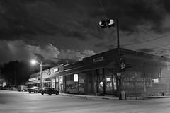 S. Maple Street (CardsFan27) Tags: blackandwhite bw architecture night clouds d50 nikon streetlights hometown missouri storefront colecamp photofaceoffwinner pfogold