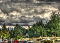 Furious Clouds (mistymisschristie) Tags: blue trees red green cars yellow clouds golf bay washington parkinglot shot foreboding gray course handheld karma chambers hdr furious awalkinthepark universityplace blueribbonwinner photomatix photoshoop allrightsreserved 3exposure elements3 golddragon anawesomeshot mistymisschristie excellentphotographerawards heartawardsgroup