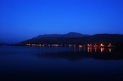 Bright lights of Leenane (George D. Allen) Tags: longexposure blue ireland sea galway night d50 landscape lights nikon availablelight tripod leenane georgeallen