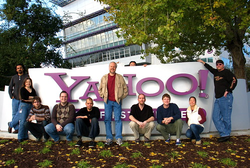 From Left: Satyen Desai, Georgiann Puckett, Nate Koechley, Lucas Pettinati, Adam Moore, Douglas Crockford, Thomas Sha (behind the sign), Luke Smith, Matt Sweeney, Jenny Donnelly, and Dav Glass. Not Pictured: Todd Kloots and Eric Miraglia.