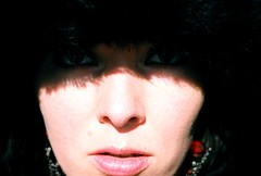 Hooded Eyes (baresilver) Tags: winter red woman sunlight selfportrait black cold me face mouth fur dramatic lips sparkle missouri hood earrings