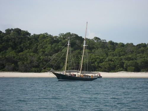 Sailboat off Whitehaven Beach